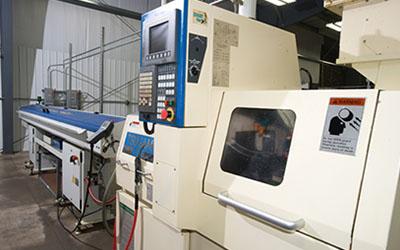 Precision Machining Technology - Tsugami BE20 w/bar feed Swiss Machine CNC Lathe
