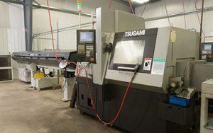 Precision Machining Technology - Tsugami SS26 w/bar feed Swiss Machine CNC Lathe