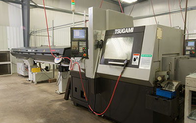 Precision Machining Technology - Tsugami SS26 w/bar feed Swiss Machine CNC Lathe