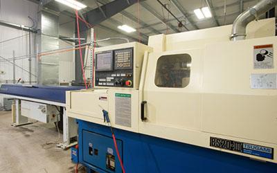 Precision Machining Technology - Tsugami BS20 w/bar feed Swiss Machine CNC Lathe