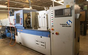 Precision Machining Technology - SAS 16.6 Tornos high volume cam screw machine
